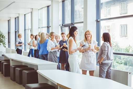 Women Having A Casual Discussing During Break In Seminar Stock Photo - Download Image Now