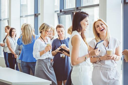 Women Having Conversation During A Break Stock Photo - Download Image Now