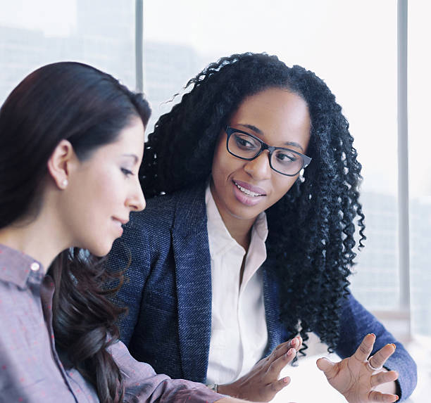 Women having conversation together in business office - Photo