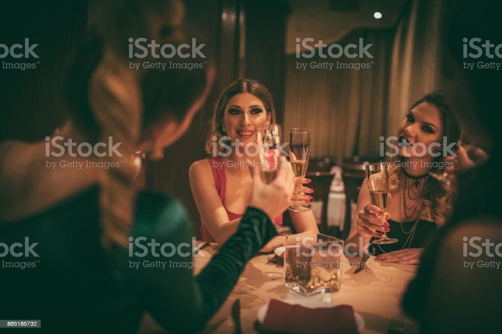 Women having dinner party stock photo