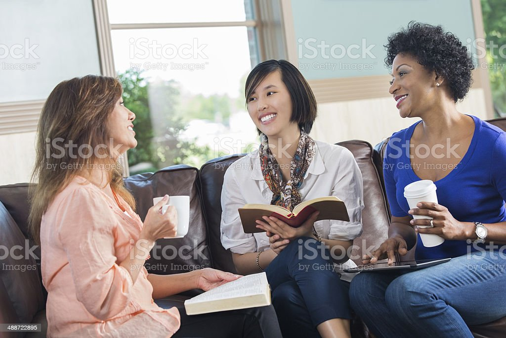 Women having discussion during book club or bible study stock photo