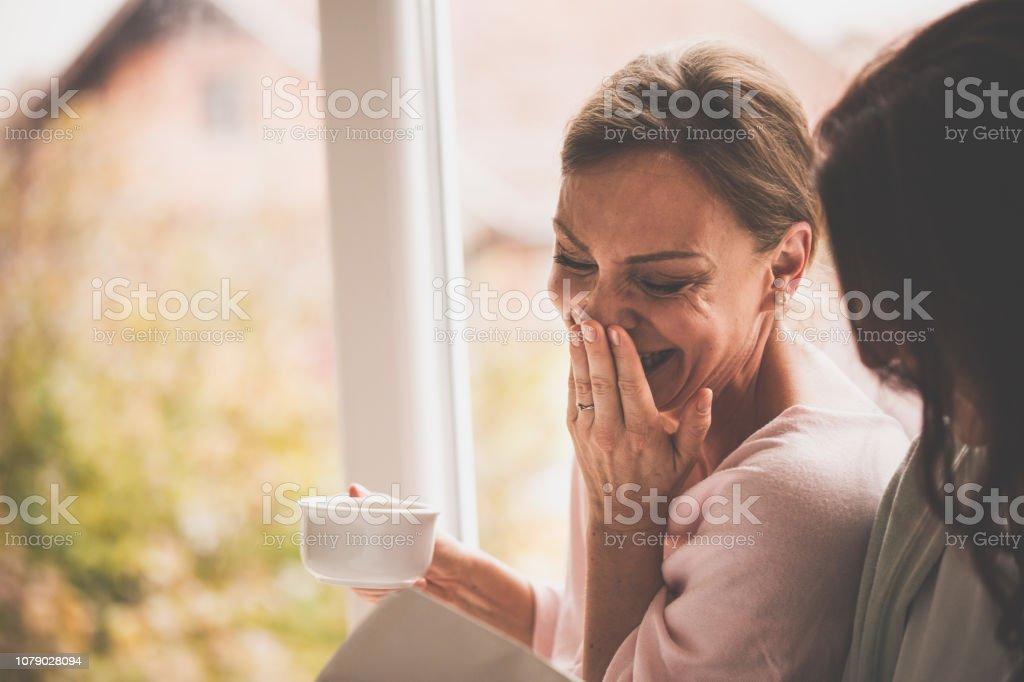Women having fun at home stock photo