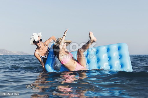 700603062istockphoto Women having fun in sea 861561166