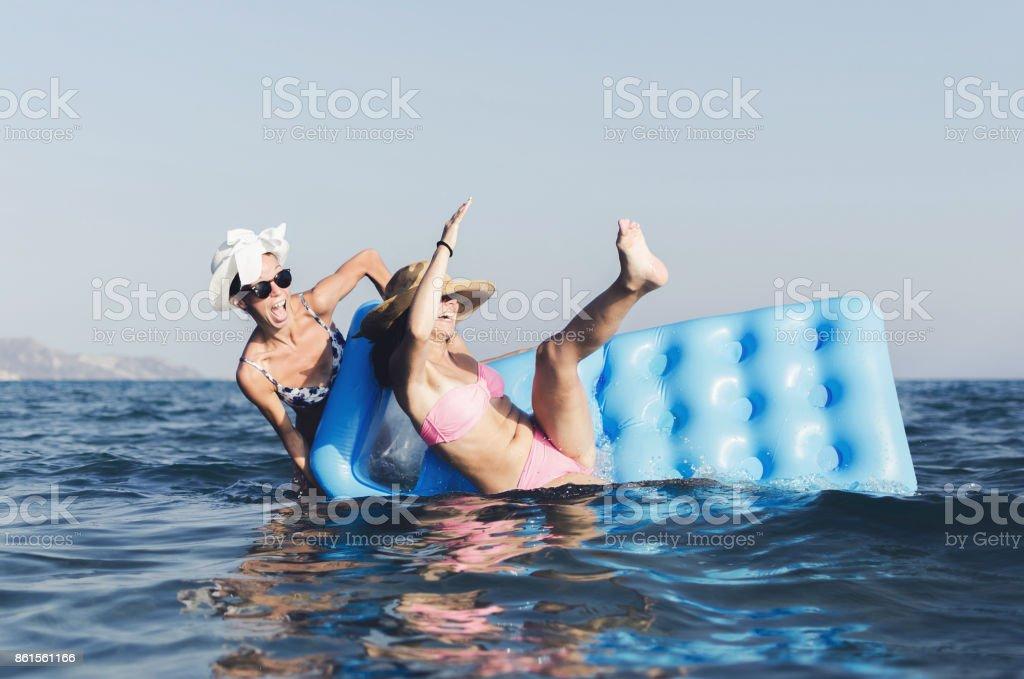 Women having fun in sea stock photo
