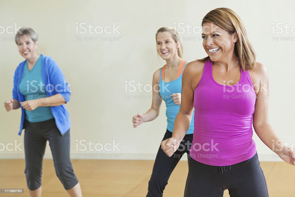 Women having fun together in fitness exercise class royalty-free stock photo