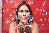 istock Women having fun with glitters 1127888226