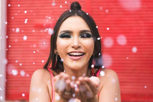 istock Women having fun with glitters 1127888988