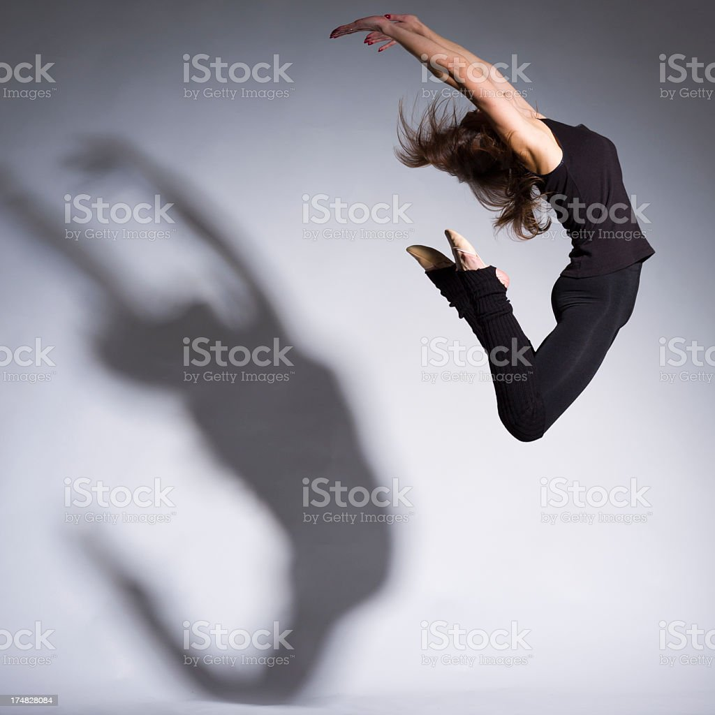 Women high jump on gray background royalty-free stock photo
