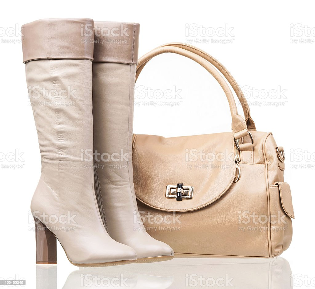 Women high-heeled boots and leather bag over white royalty-free stock photo