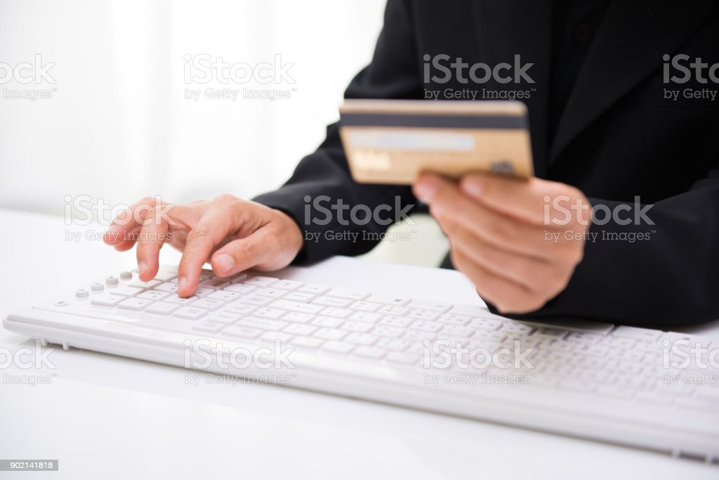 Women hold credit cards for online shopping. Internet purchase is popular because it is convenient, economical and secure. stock photo