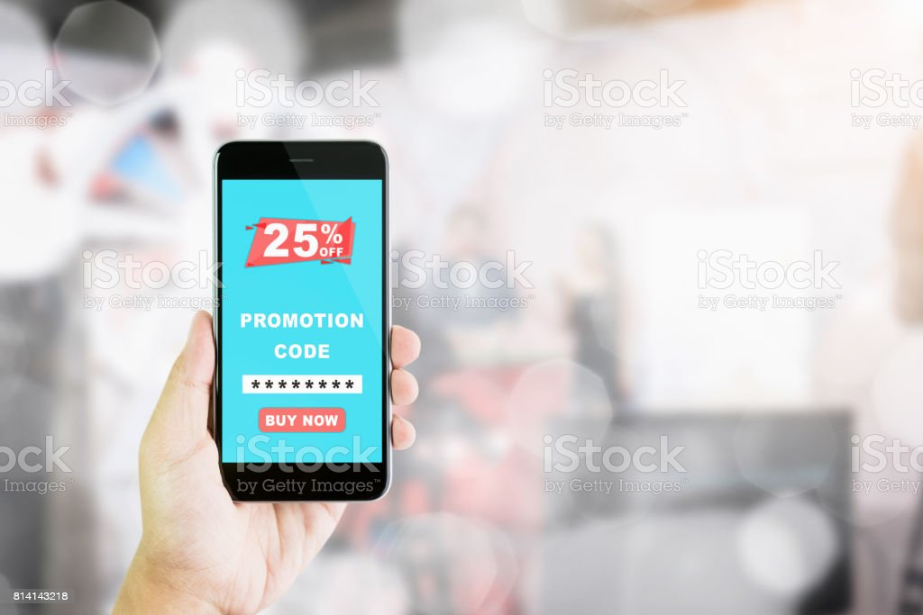 Women hold the phone to enter the code to get a discount from the store. The concept of providing marketing services on the internet for easy access to information. stock photo