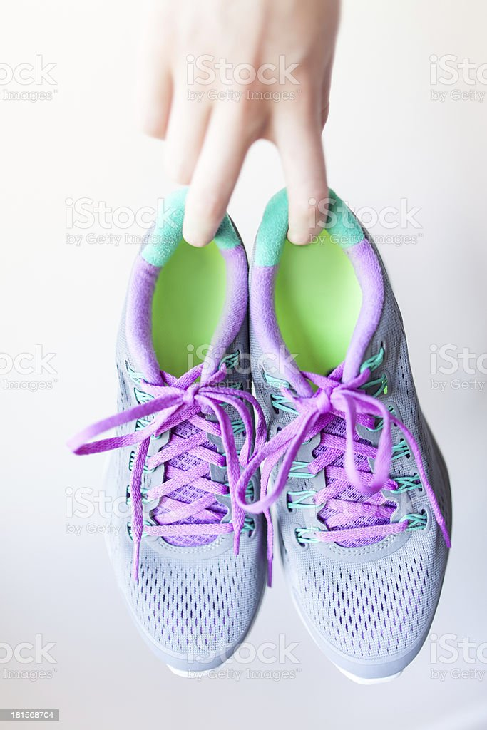 women holding a pair of feminine trainers royalty-free stock photo