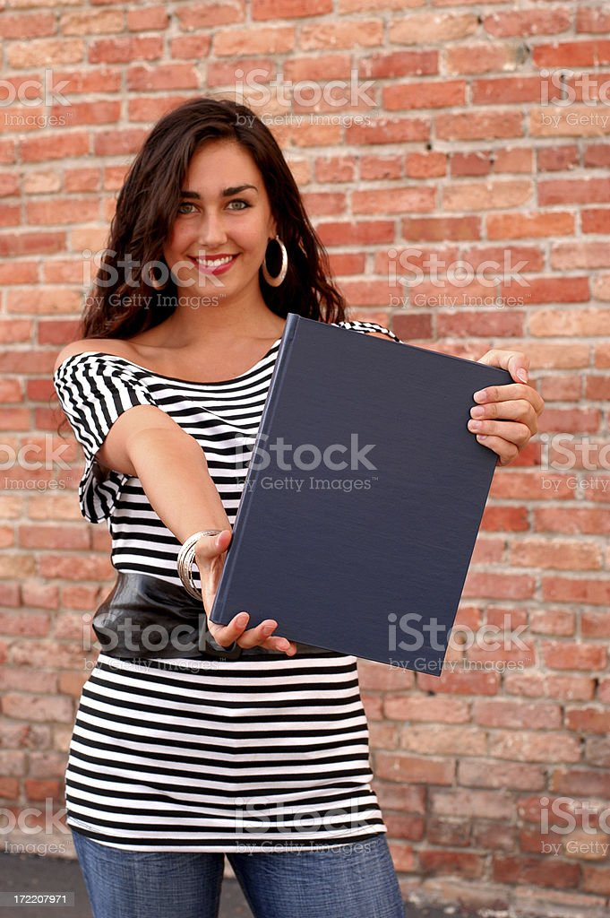 Women holding blank book outside smiling royalty-free stock photo