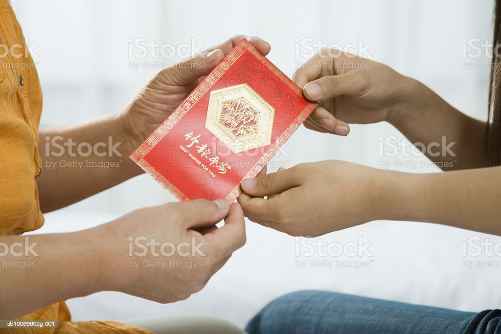 Women holding good luck envelope royalty-free stock photo