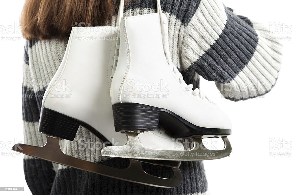 Women holding ice skates royalty-free stock photo
