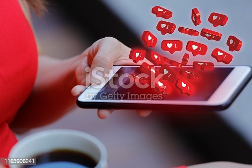 Women holding mobile phone with social media notification icon