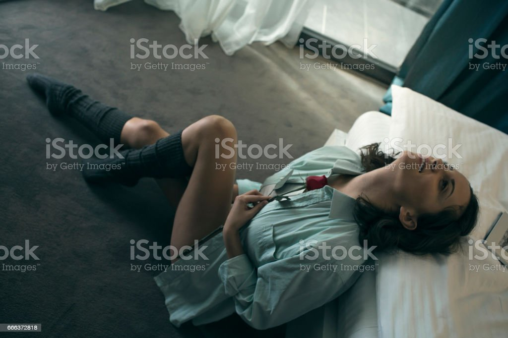 Women holding rose on her chest stock photo