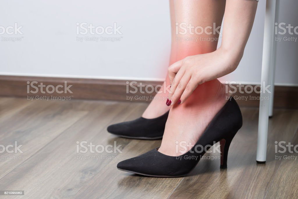 Women hurt their ankles because of high heels. stock photo