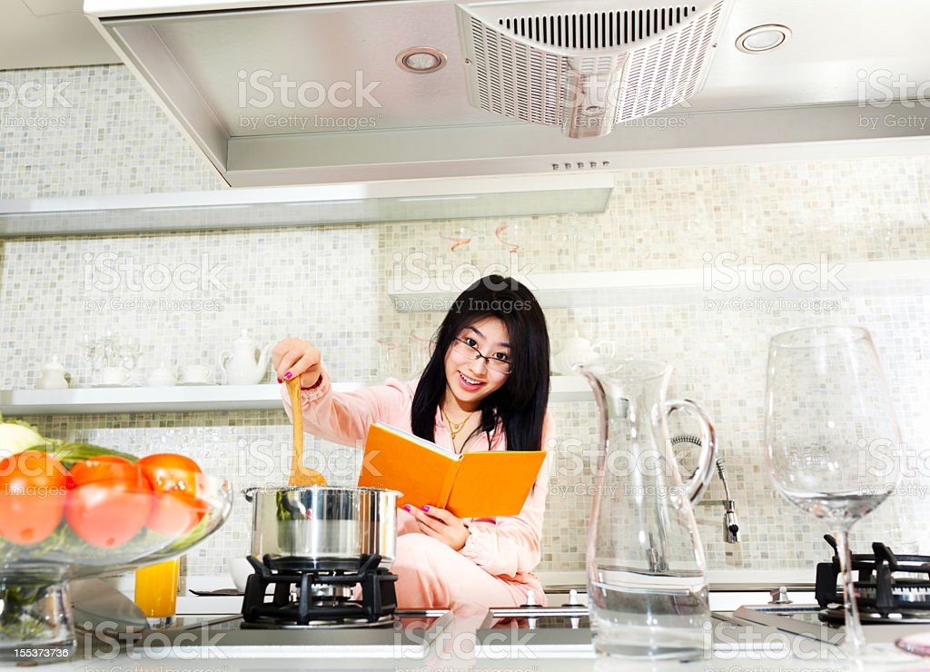 Women in a kitchen royalty-free stock photo