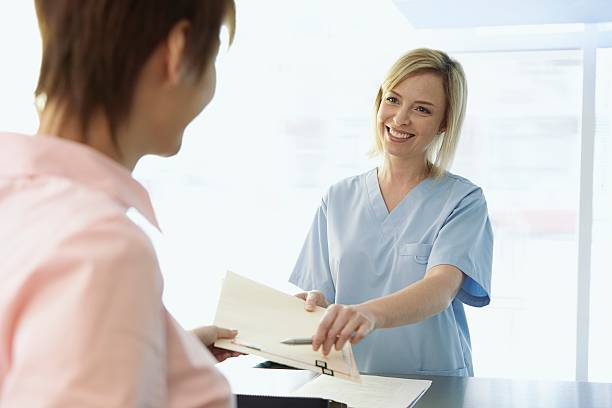 Women in a medical office stock photo