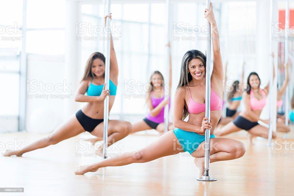 Women in a pole dance class stock photo