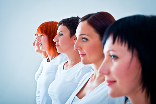 Women In A Row Stock Photo - Download Image Now