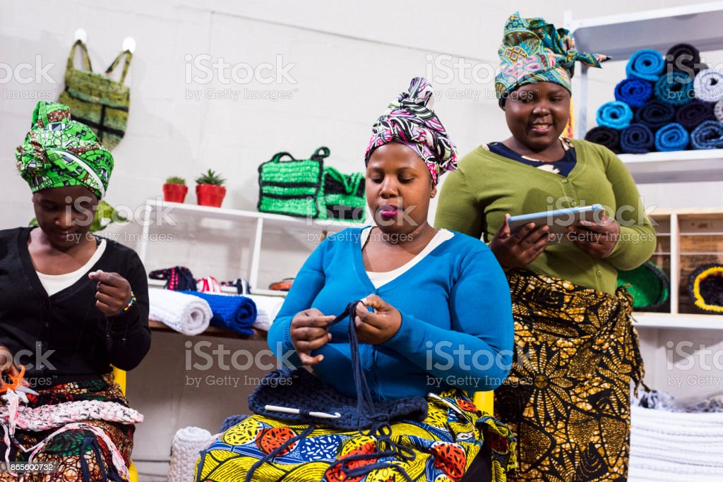 Women in a workshop learning new skills stock photo