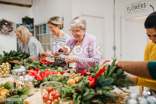 istock Women in a Wreath Making Workshop 1148223473