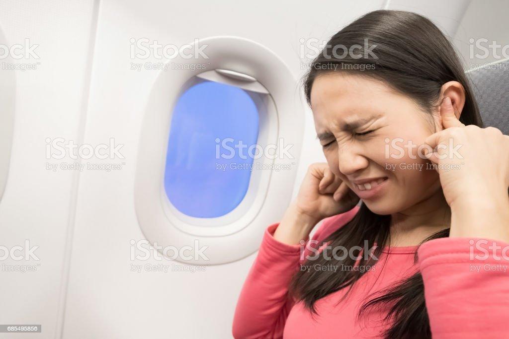 women in airplane stock photo