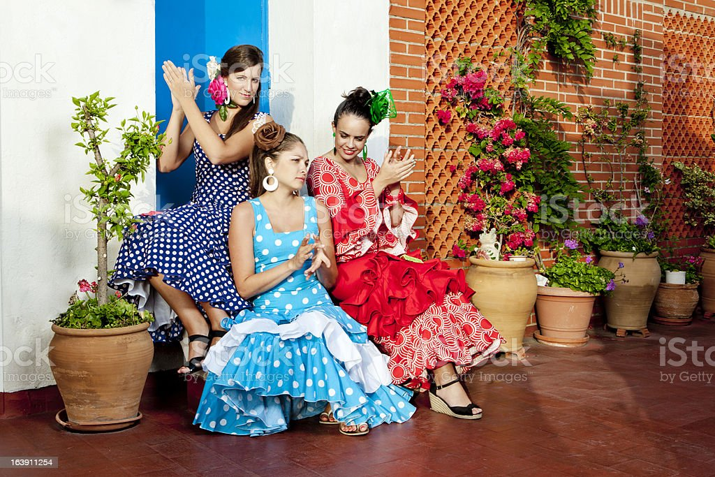 Women in Andalusian Dresses Clapping royalty-free stock photo