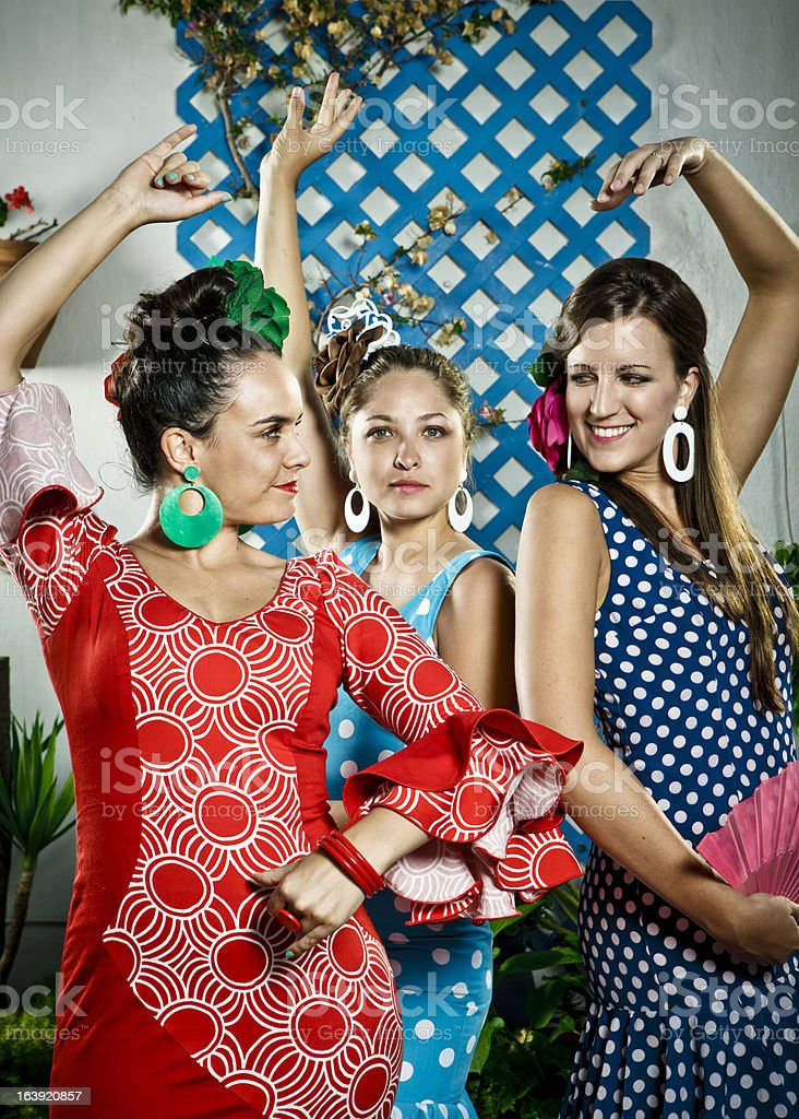Women in Andalusian Dresses Dancing stock photo