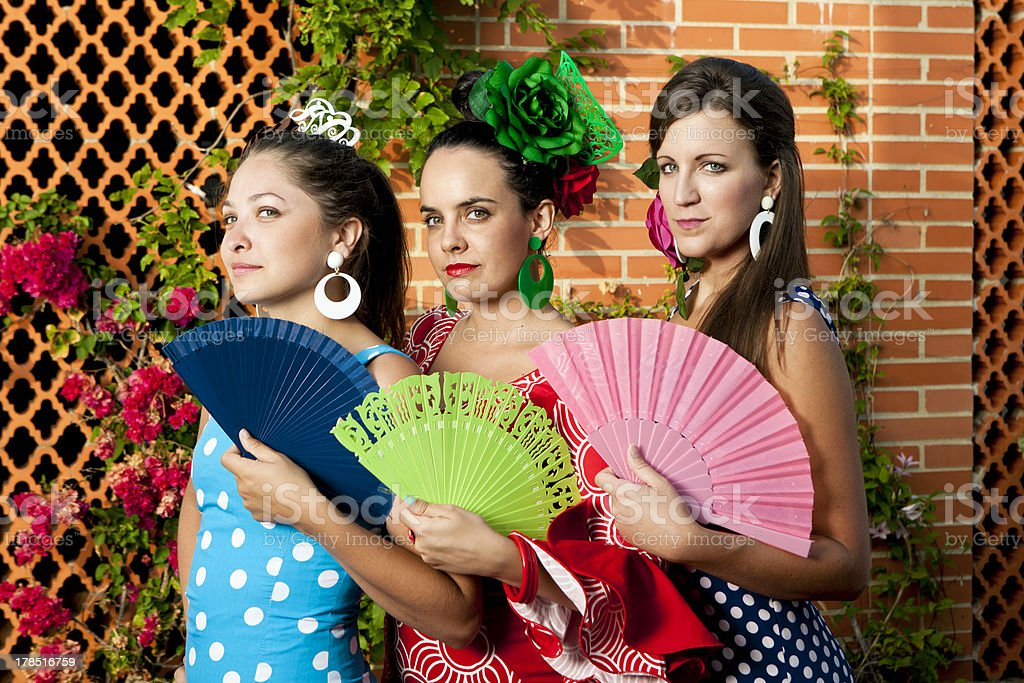 Women in Andalusian Dresses Holding Fans royalty-free stock photo