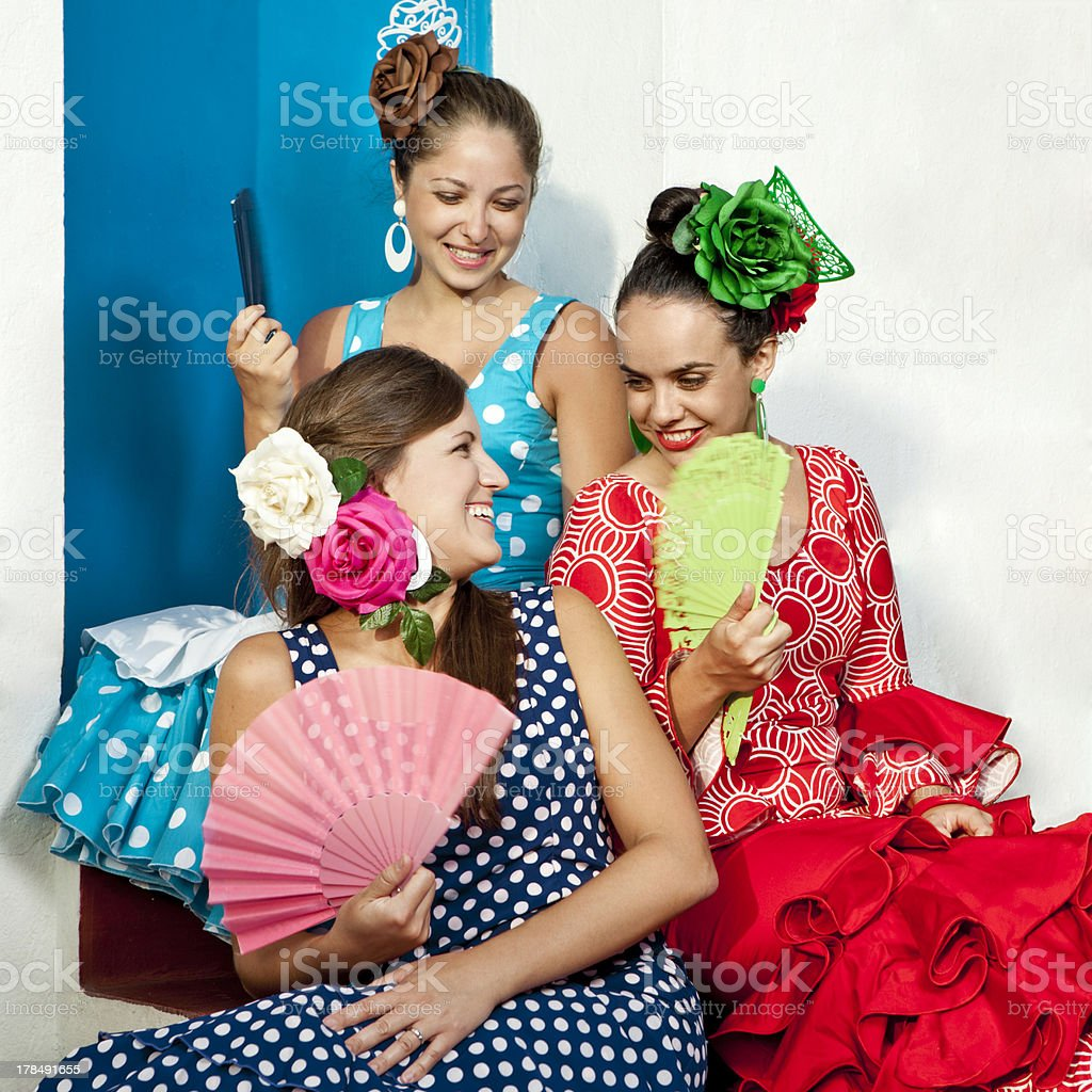Women in Andalusian Dresses Talking royalty-free stock photo