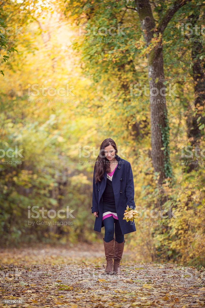 women in autumn forest stock photo