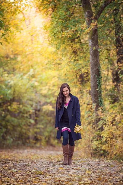 women in autumn forest stock photo