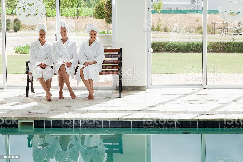 Women in bathrobes and hair wrapped in towels at spa royalty-free stock photo