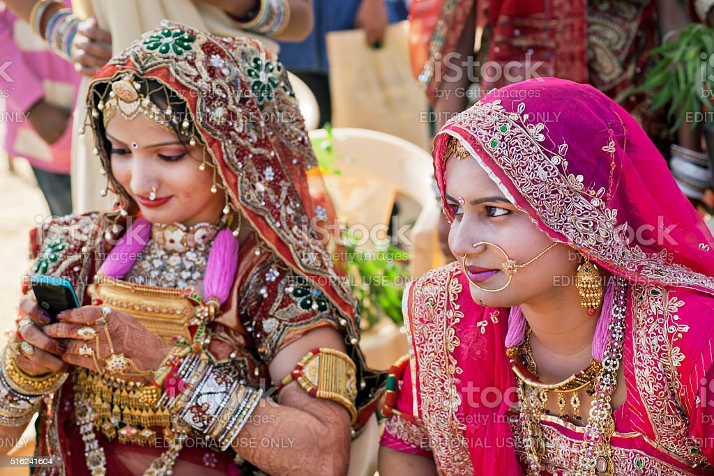 Women in beautiful indian dresses and gold jewelry stock photo