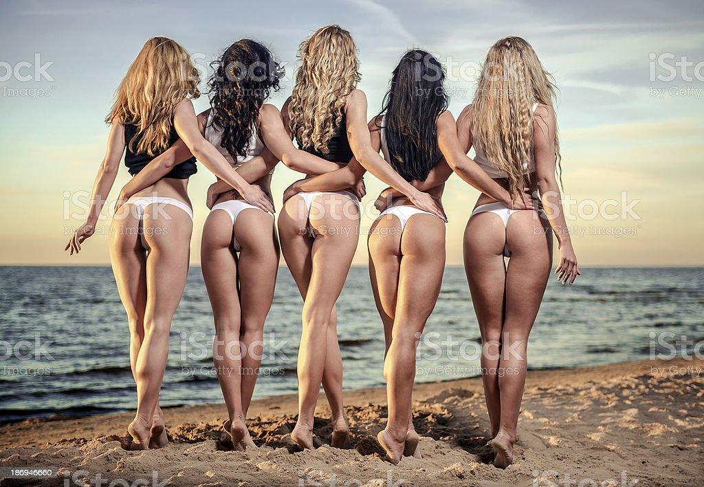 Women in bikini on the beach royalty-free stock photo
