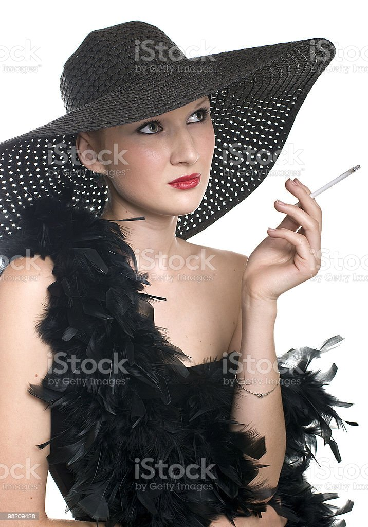 women in black hat and boa with a cigarette royalty-free stock photo