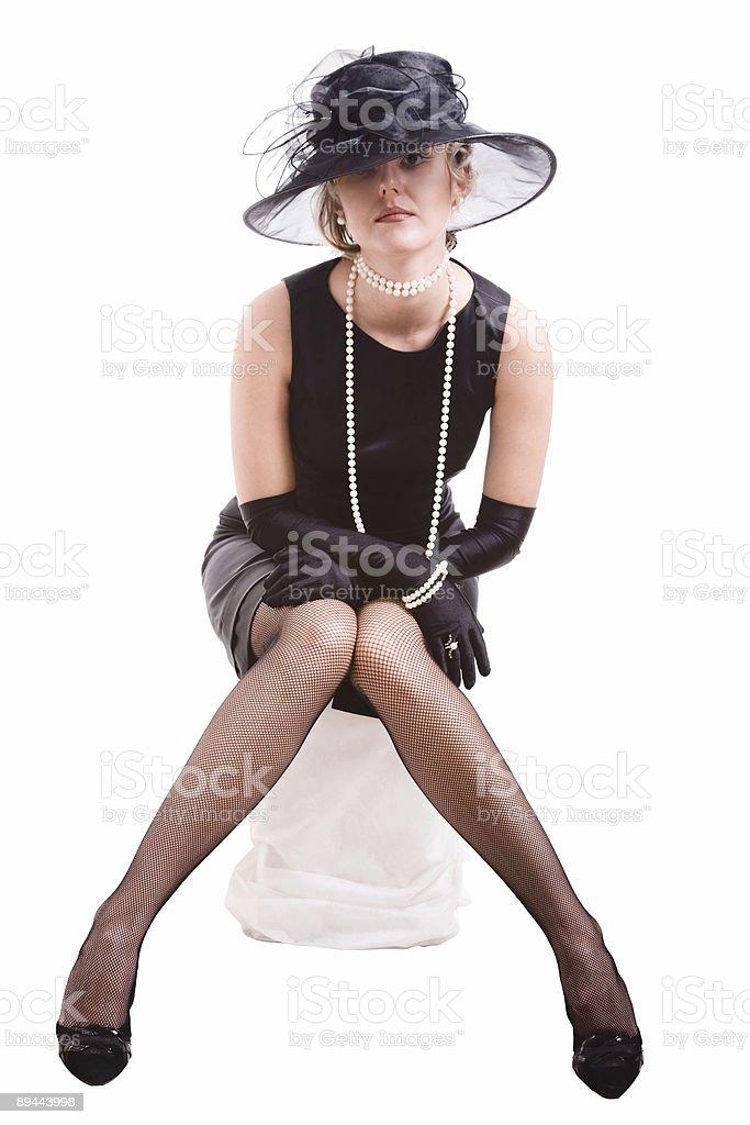women in black sitting on pedestal royalty-free stock photo