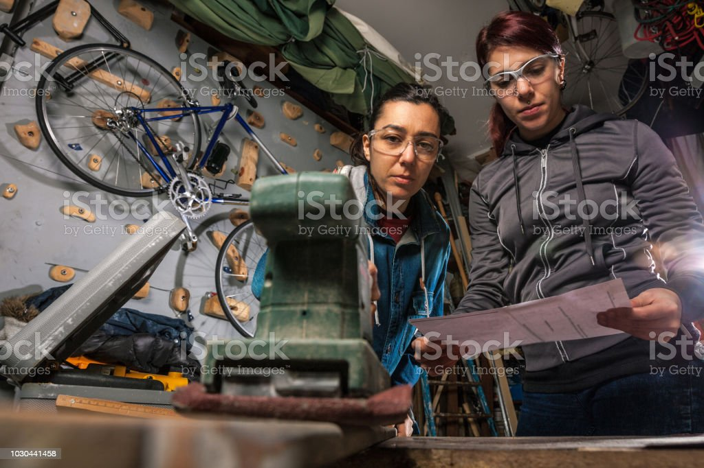 Women in business, working in a garage stock photo