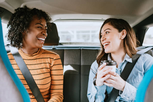 women in car rideshare in city of los angeles - rideshare stock photos and pictures