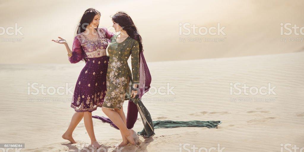 Women in desert landscape. Travel concept stock photo