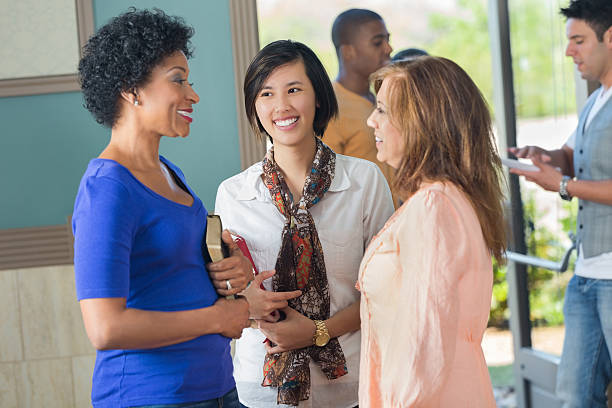 women in discussion holding religious texts - african american church stock pictures, royalty-free photos & images
