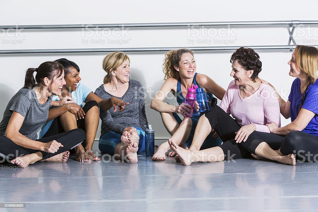 Women in exercise class, taking break stock photo