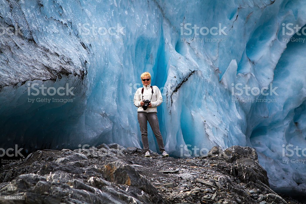 Women in front of a glacier stock photo