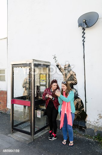 506166130 istock photo Women in front of a possible Banksy artwork, Cheltenham 485964159