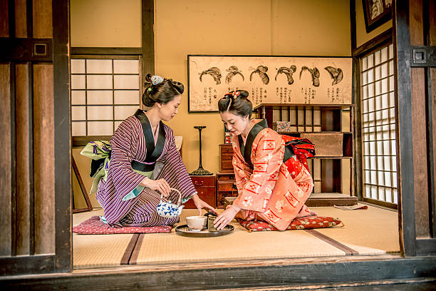 women in kimono drinking matcha tea, edo period, kyoto, japan - ceremonie stockfoto's en -beelden