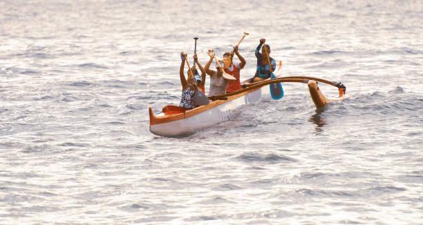 Women in outrigger canoe stock photo
