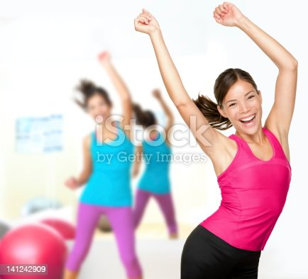 istock Women in pink and blue doing a Zumba dance 141242909